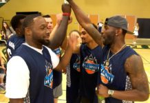 Celebrity Basketball Game Event team high-fives