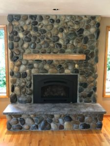 Professional Stone Products River rock fireplace after