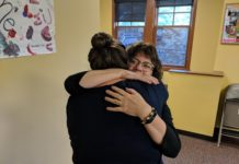 South Sound Parent to Parent Kim Smith hugging an employee