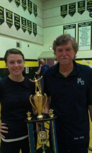 Coaches Jack and Sarah Lizee proudly holding up the first place trophy from the North Beach Tournament.