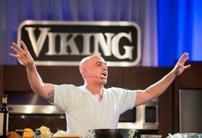 Chef Michael Symon not only cooked a delicious meal but helped inspire a record setting night of fundraising.