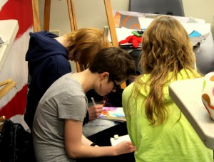 Students work diligently on their art finals to be presented at the end of the semester.