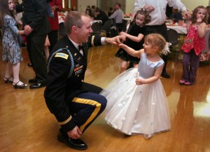 Kearen Feller dances with his delighted 4-year-old daughter, Skye Feller during the Daddy Daughter Dance hosted by Lacey Parks and Rec at The Lacey Community Center.