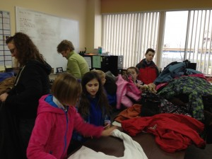 Student Council members sort coats from Serendipity Academy's winter coat drive with One Warm Coat.
