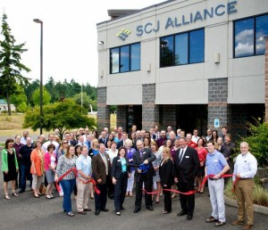 In June 2014, SCJ President Perry Shea cuts the ribbon for the grand opening of SCJ Alliance's new, expanded headquarters in Lacey, WA.
