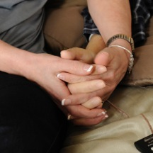Interlocking hands are a symbol of connection and love especially poignant to caregivers. Photo of Navigating Grief founder Joan Hitchens and husband Dave during his time on hospice service.