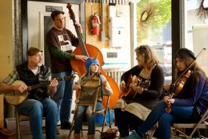 Family stringband Fiddlie-I-Ay welcomes visitors to Arbutus Folk School at Spring Arts Walk 2014 in downtown Olympia, sponsored by City of Olympia Parks, Arts & Recreation and the Olympia Arts Commission. Photo courtesy City of Olympia.