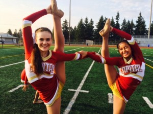 Juniors Emily Cronk and Amy Ly display their flexibility in a bow and arrow pose.