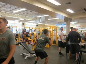 Capital Footbal players wear their C.A.D. shirts during weight training to remind them of their committment.