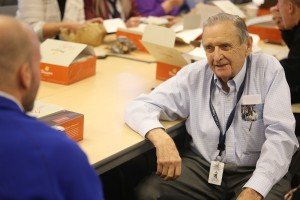 Dick Kay listens as friends tell stories during his retirement party last week.