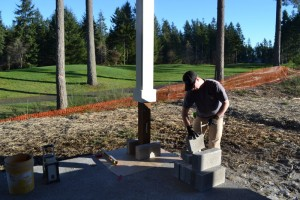 Masonry is crafted when the weather permits at this home on a lovely golf course.