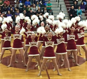 The Cougarettes get fired up for their award winning pom routine.