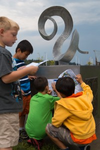 Young art enthusiasts from City of Olympia's Camp Olywahoo check out Full Curl by Rodger Squirrell, part of the 2014 Percival Plinth sculpture exhibition.  Photo courtesy City of Olympia.