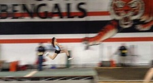 Peyton Russell flies through the air during the triple jump during the 2014 Simplot Games.