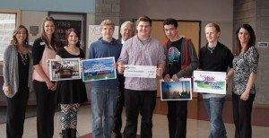 Yelm High School Students with their winning designs (l to r) Alicia Damron and Shannon Grant of O Bee Credit Union, Cheyenne Lombardi, Tyler McIntosh, Lee Wojnar of O Bee Credit Union, Ernest Ziegenfelder, Cam'ron Stovall, Quinton Lincoln and Shauna Hergert of O Bee.