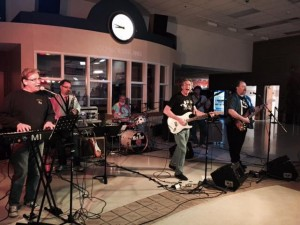 The band always welcomes guest performers. Pictured here (second from left) is guest Paul Rae on saxophone at the Olympia High School Sock Hop.