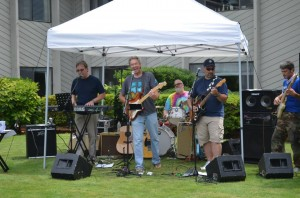 Here, Mick Hart and the Classic Vinyl Band performs at a Hot Rod show in Tumwater at the Olympics West Retirement Inn.
