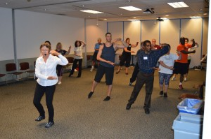 Jan Voit, PT teaches a group of community fitness instructors in Tai Ji Quan: Moving for Better Balance®.