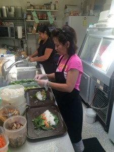 Kim Nguyn (right) and Bibiana Smith work behind the scenes at Soba to prepare for the daily lunch rush.