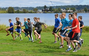 The Northwest Christian's boys' cross country team warms up prior to a run around Capitol Lake.