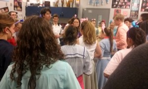 NTHS Drama Department head and show Director Kathrine Deneen gives the cast a pep talk before the show.