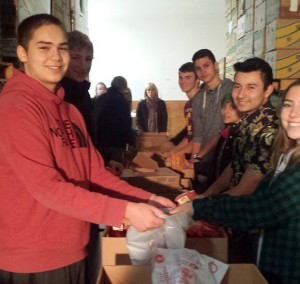 DECA students help sort donations at the Thurston County Food Bank.