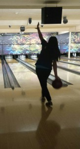 OHS bowling team member Justina Dizon aims for a strike during a non-team practice session at Aztec Lanes.