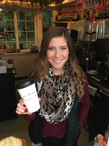 Roddie Giroux presents a fresh drink to a customer at Madre's Coffee where she earns spending money as well as helped pay for her summer trip to Europe.