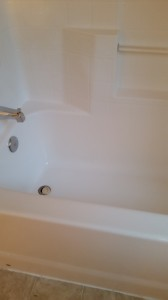 After the Maid Perfect staff cleaned this shower with Bar Keepers Friend, it looks nearly brand new.