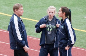 Coach Michael spends time strategizing with his runners before their race.
