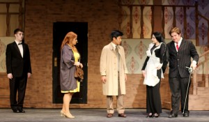 The Addams parents, Morticia (second from right) and Gomez (far right) are played by CHS seniors Sophie Parody and Ryan Grey.