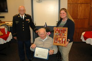 Darld Brannan (left) poses with retired Col. Thomas Fitzgerald (seated) and Fitzgerald's daughter, Sarah, following the pining ceremony.  Photo courtesy: Providence.