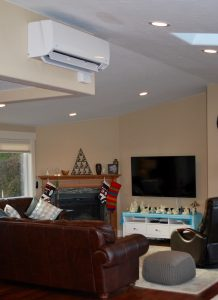 Ductless heat pumps are easily mounted high on a wall where they can distribute warm and cool air throughout the space.
