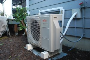 The exterior unit of a ductless heat pump is compact and can be installed easily along side your home or office.