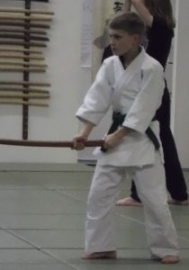 Aikido Olympia Alex trains with a bokken