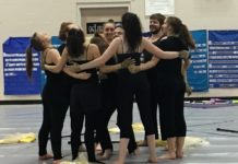 North Thurston High School Winterguard group huddle