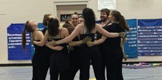 North Thurston High School Winterguard group huddle