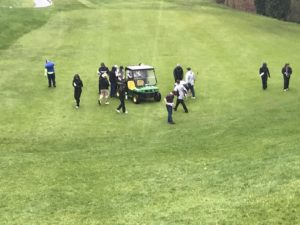 Olympia Country and Golf Club CHS Boys Golf replacing divots