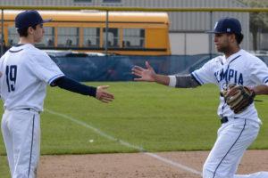 Olympia High School Baseball Derek Weldon Kevin Flannery (No. 19) and Zach Johnson (No. 3)