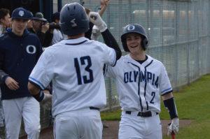 Olympia High School baseball Derek Weldon Jacob Schmaltz (No. 2) with Clyde Twitty (No. 13)