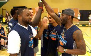 Celebrity Basketball Game Event team high-fives