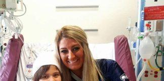 Kara with kid in hospital