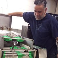 Olympia Food CoOp Eddie Lucero rollin' out the Green Jalisco Tortillas