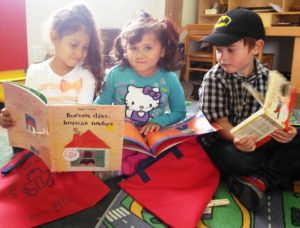 Child Care Action Council Raising a Reader kids red book bags