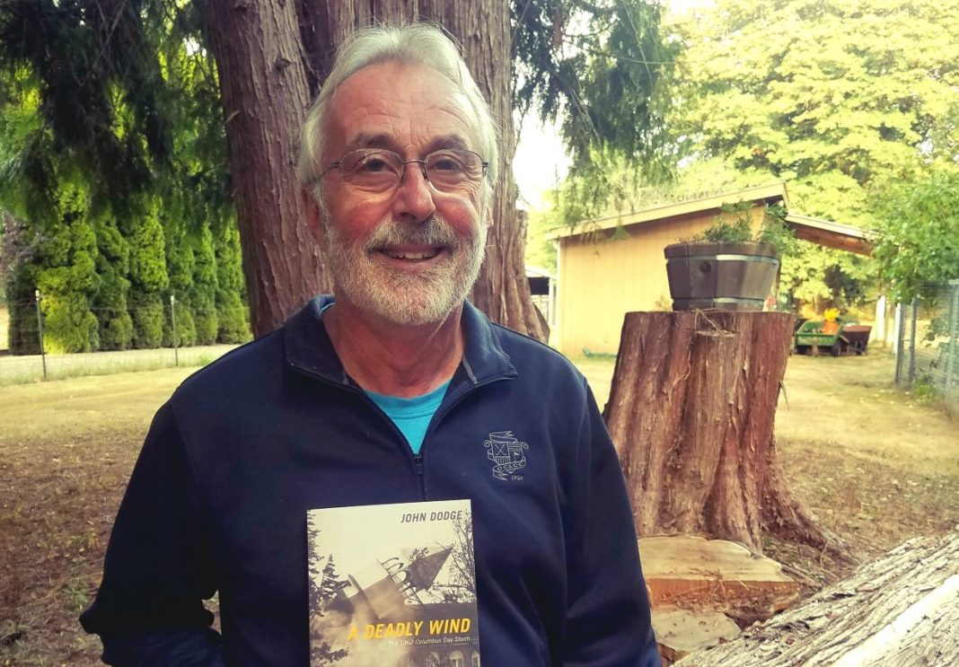 John Dodge Deadly Winds Holding his Book at his farm