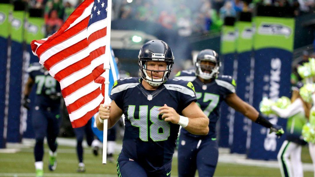 Nate Boyer Carries Seahwaks Flag