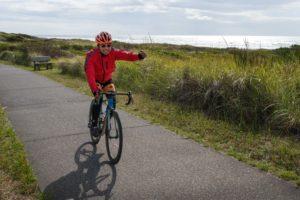reach the beach cyclist on path