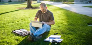 Comcast Veteran on Laptop Sitting in the Grass