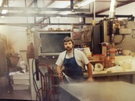 Northwest Sausage & Deli Dick cleaning up after processing meat