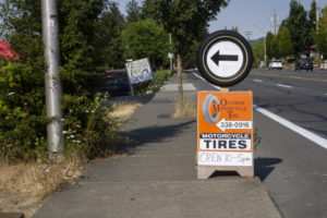 Olympia Motorcycle Tires Signage